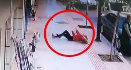 Balkondan düşen kadının altında kalmaktan saniye farkıyla kurtuldu